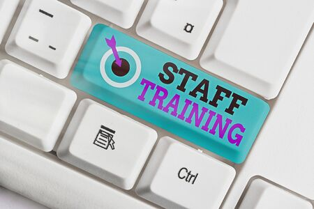 Writing note showing Staff Training. Business concept for A program that helps employees to learn specific knowledge Archivio Fotografico
