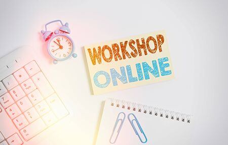 Writing note showing Workshop Online. Business concept for room or building in which goods are manufactured repaired Keyboard with empty note paper and pencil white background