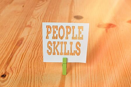 Handwriting text People Skills. Conceptual photo Get Along well Effective Communication Rapport Approachable Empty reminder wooden floor background green clothespin groove slot office
