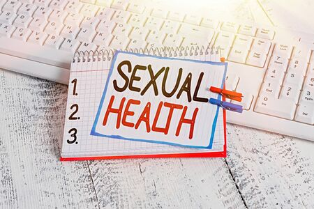 Text sign showing Sexual Health. Business photo showcasing Healthier body Satisfying Sexual life Positive relationships notebook paper reminder clothespin pinned sheet white keyboard light wooden