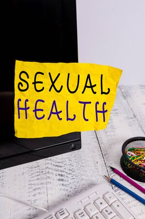Text sign showing Sexual Health. Business photo showcasing Healthier body Satisfying Sexual life Positive relationships Note paper taped to black computer screen near keyboard and stationary Фото со стока