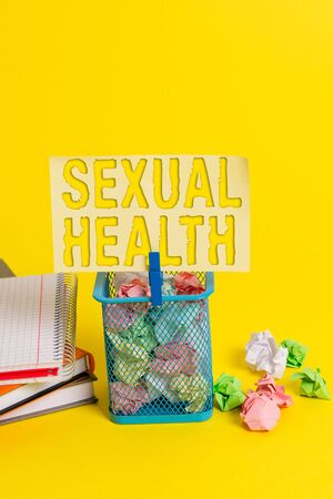 Writing note showing Sexual Health. Business concept for Healthier body Satisfying Sexual life Positive relationships Trash bin crumpled paper clothespin office supplies yellow