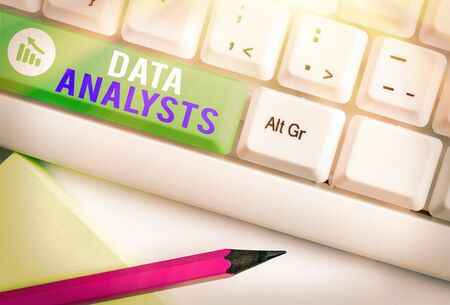 Writing note showing Data Analysts. Business concept for Programmer Design and Create Report Identifies patterns