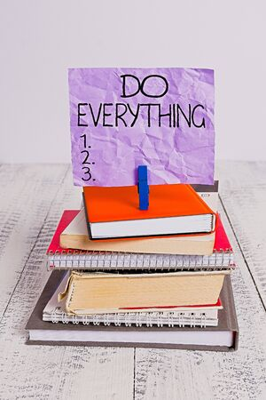 Handwriting text Do Everything. Conceptual photo Jack of All Trades Self Esteem Ego Pride No Limits pile stacked books notebook pin clothespin colored reminder white wooden