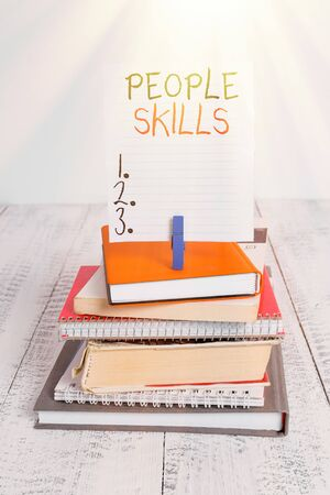 Word writing text People Skills. Business photo showcasing Get Along well Effective Communication Rapport Approachable pile stacked books notebook pin clothespin colored reminder white wooden 写真素材