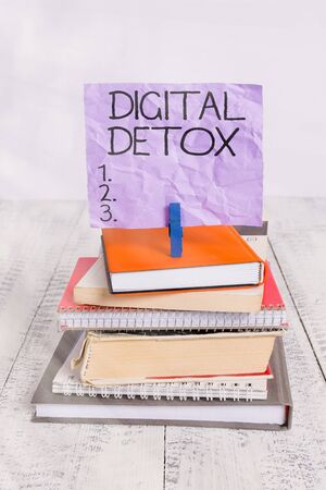Handwriting text Digital Detox. Conceptual photo Free of Electronic Devices Disconnect to Reconnect Unplugged pile stacked books notebook pin clothespin colored reminder white wooden