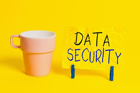 Conceptual hand writing showing Data Security. Concept meaning Confidentiality Disk Encryption Backups Password Shielding Paper blue clothespin rectangle shape reminder yellow office