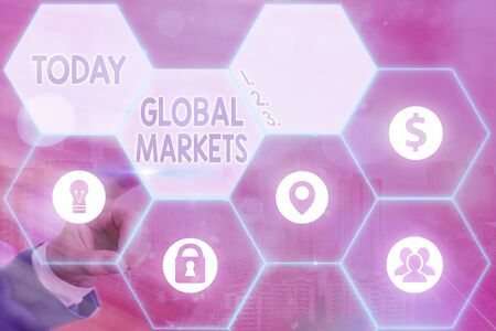 Writing note showing Global Markets. Business concept for Trading goods and services in all the countries of the world