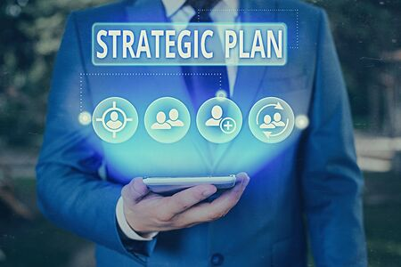 Writing note showing Strategic Plan. Business concept for A process of defining strategy and making decisions