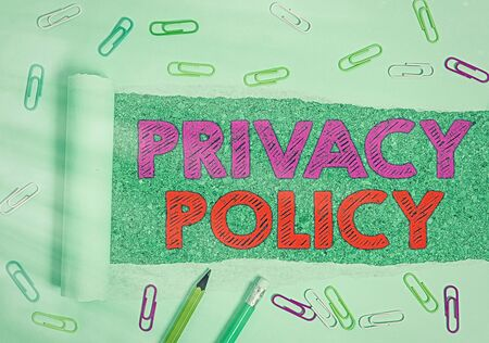 Writing note showing Privacy Policy. Business concept for Document that explains how an organization handles clients