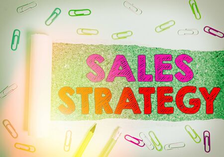 Writing note showing Sales Strategy. Business concept for Plan for reaching and selling to your target market Marketing