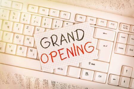 Writing note showing Grand Opening. Business concept for Ribbon Cutting New Business First Official Day Launching Keyboard office supplies rectangle shape paper reminder wood Imagens