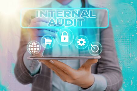Handwriting text writing Internal Audit. Conceptual photo Evaluates the effectiveness of the controls and processes
