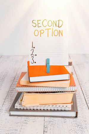 Word writing text Second Option. Business photo showcasing Next Fiddle Not a priority Next Alternative Opportunity pile stacked books notebook pin clothespin colored reminder white wooden