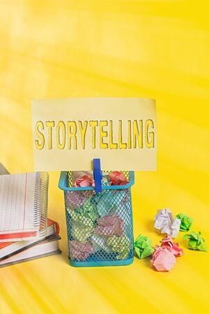 Writing note showing Storytelling. Business concept for social and cultural Activity with Theatrical Gestures Trash bin crumpled paper clothespin office supplies yellow