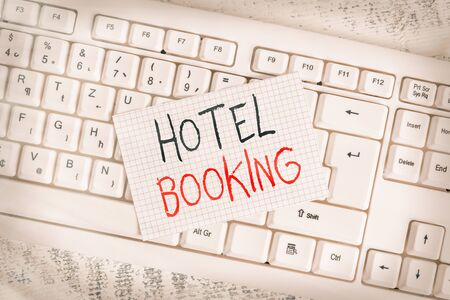 Writing note showing Hotel Booking. Business concept for Online Reservations Presidential Suite De Luxe Hospitality Keyboard office supplies rectangle shape paper reminder wood