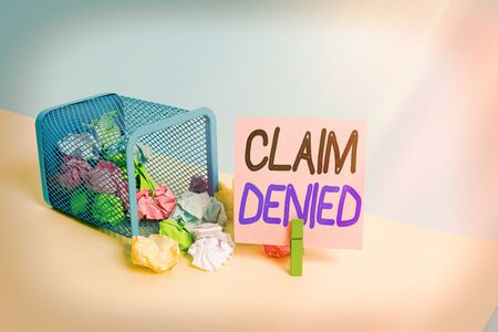 Writing note showing Claim Denied. Business concept for Requested reimbursement payment for bill has been refused Trash bin crumpled paper clothespin reminder office supplies