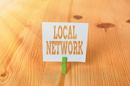 Handwriting text Local Network. Conceptual photo Intranet LAN Radio Waves DSL Boradband Switch Connection Empty reminder wooden floor background green clothespin groove slot office