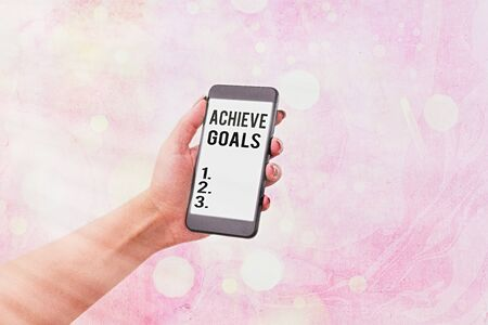 Writing note showing Achieve Goals. Business concept for Results oriented Reach Target Effective Planning Succeed