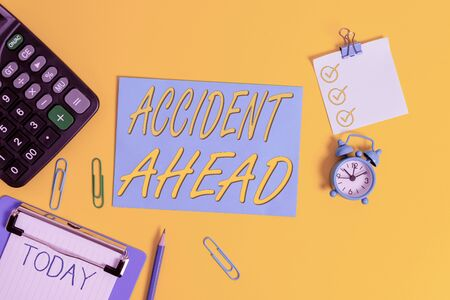 Conceptual hand writing showing Accident Ahead. Concept meaning Unfortunate event Be Prepared Detour Avoid tailgating Clipboard clips sheet calculator pen clock color background