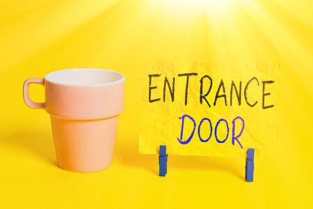 Conceptual hand writing showing Entrance Door. Concept meaning Way in Doorway Gate Entry Incoming Ingress Passage Portal Paper blue clothespin rectangle shape reminder yellow office