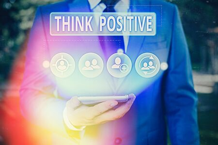 Writing note showing Think Positive. Business concept for The tendency to be positive or optimistic in attitude 版權商用圖片