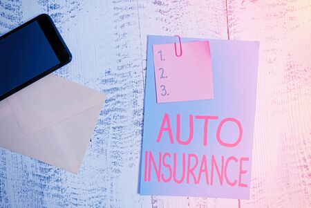 Text sign showing Auto Insurance. Business photo showcasing Protection against financial loss in case of accident Envelope blank sheet paper sticky note smartphone wooden vintage background Zdjęcie Seryjne