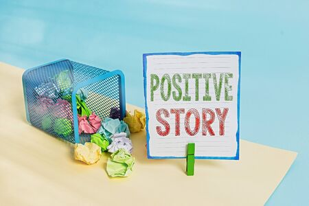 Handwriting text Positive Story. Conceptual photo Meaningful and motivating article Good News Success scoop Trash bin crumpled paper clothespin empty reminder office supplies tipped