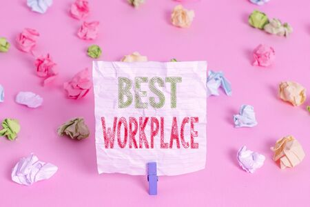 Text sign showing Best Workplace. Business photo showcasing Ideal company to work with High compensation Stress free Colored crumpled papers empty reminder pink floor background clothespin