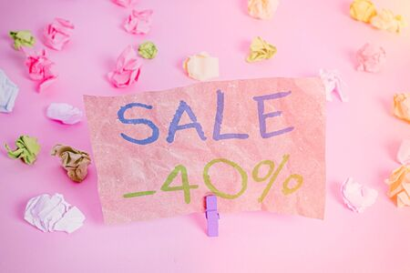 Conceptual hand writing showing Sale 40 Percent. Concept meaning A promo price of an item at 40 percent markdown Colored crumpled papers empty reminder pink floor clothespin