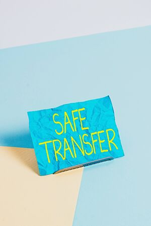Conceptual hand writing showing Safe Transfer. Concept meaning Wire Transfers electronically Not paper based Transaction Paper on buffer wire on soft pastel multi colours backdrop Stock Photo