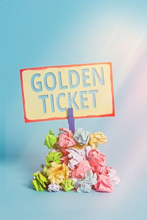 Text sign showing Golden Ticket. Business photo text Rain Check Access VIP Passport Box Office Seat Event Reminder pile colored crumpled paper clothespin reminder blue background