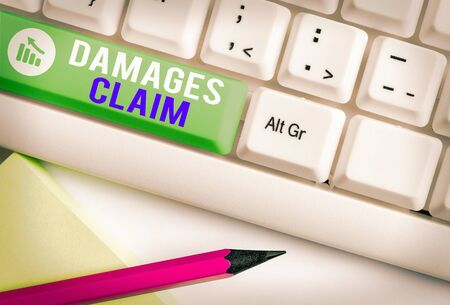 Writing note showing Damages Claim. Business concept for Demand Compensation Litigate Insurance File Suit