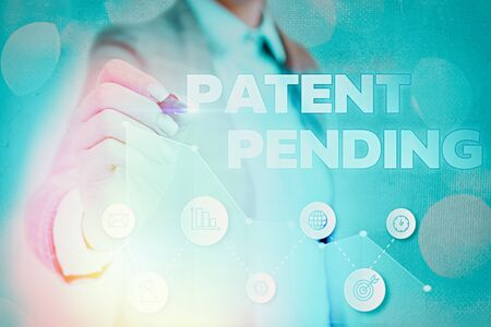 Writing note showing Patent Pending. Business concept for Request already filed but not yet granted Pursuing protection