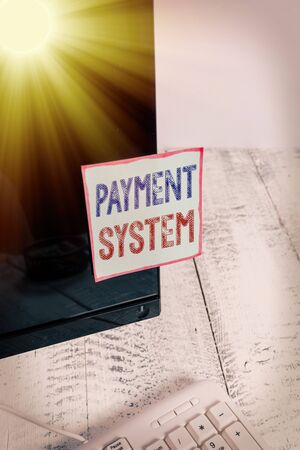 Text sign showing Payment System. Business photo showcasing Compensation Scheme Method used in paying goods and services Notation paper taped to black computer monitor screen near white keyboard