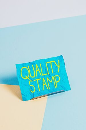 Conceptual hand writing showing Quality Stamp. Concept meaning Seal of Approval Good Impression Qualified Passed Inspection Paper on buffer wire on soft pastel multi colours backdrop