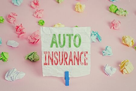Text sign showing Auto Insurance. Business photo showcasing Protection against financial loss in case of accident Colored crumpled papers empty reminder pink floor background clothespin