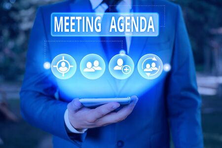 Writing note showing Meeting Agenda. Business concept for An agenda sets clear expectations for what needs to a meeting Zdjęcie Seryjne