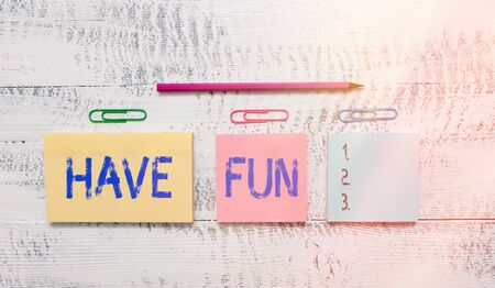 Text sign showing Have Fun. Business photo text wish somebody good and enjoyable time when they do something Multicolor blank notepads clips marker pencil wooden vintage background