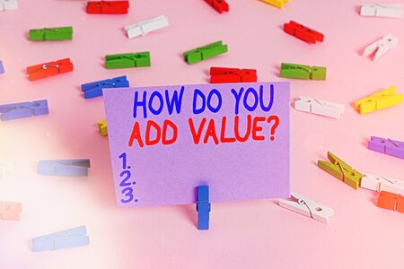 Handwriting text writing How Do You Add Value Question. Conceptual photo improve work undertaking production process Colored clothespin papers empty reminder pink floor background office pin