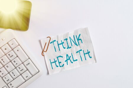 Handwriting text Think Health. Conceptual photo state of complete physical mental and social well being White pc keyboard with empty note paper above white background and mobile phone 版權商用圖片