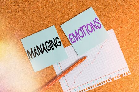 Text sign showing Managing Emotions. Business photo text ability be open to feelings and modulate them in oneself Desk notebook paper office cardboard paperboard study supplies table chart Banque d'images