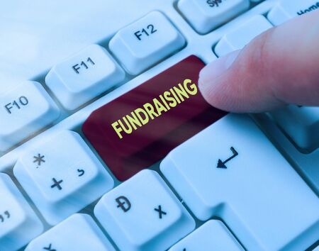 Word writing text Fundraising. Business photo showcasing seeking to generate financial support for charity or cause