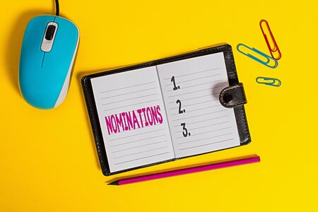 Writing note showing Nominations. Business concept for action of nominating or state being nominated for prize Leather locked diary striped sheets marker mouse colored background