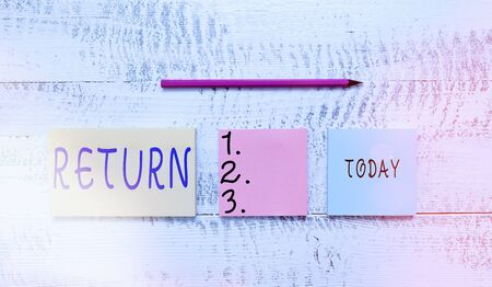 Handwriting text writing Return. Conceptual photo come or go back to a place or an individual Give money you took before Three multicolor blank notepads marker pencil wooden vintage background