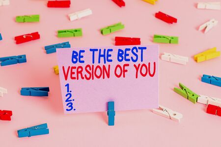 Handwriting text writing Be The Best Version Of You. Conceptual photo going to move away from where are start improving Colored clothespin papers empty reminder pink floor background office pin Фото со стока