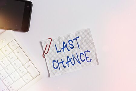 Handwriting text Last Chance. Conceptual photo final opportunity to achieve or acquire something you want White pc keyboard with empty note paper above white background and mobile phone