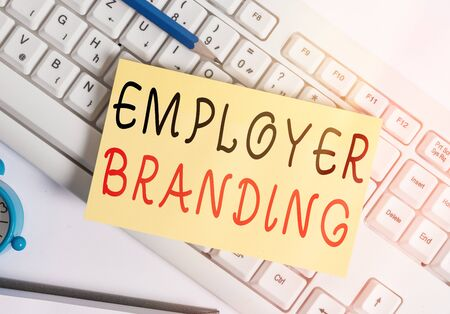 Writing note showing Employer Branding. Business concept for promoting company employer choice to desired target group White pc keyboard note paper and paper clips above white background Stock Photo
