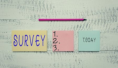 Handwriting text writing Survey. Conceptual photo look closely at or examine someone or something Record area Three multicolor blank notepads marker pencil wooden vintage background