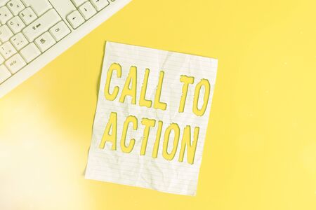 Text sign showing Call To Action. Business photo showcasing exhortation do something in order achieve aim with problem Copy space on notebook above yellow background with pc keyboard on the table